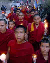 Tibetan protesters in exile hold a candlelight vigil as part of an anti-China demonstration.