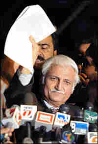 Farhatullah Babar reads a statement from the Pakistan Peoples Party.