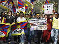 Tibetan demonstrators in exile shout slogans during a protest in New Delhi, India.