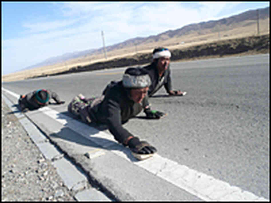 Pilgrims prostrating themselves near Qinghai Lake.