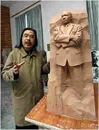 Lei Yixin shows off a model of a Martin Luther King Jr. statue.