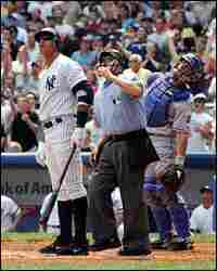 Alex Rodriguez watches the ball stay fair as Jerry Meals and Jason LaRue look on.