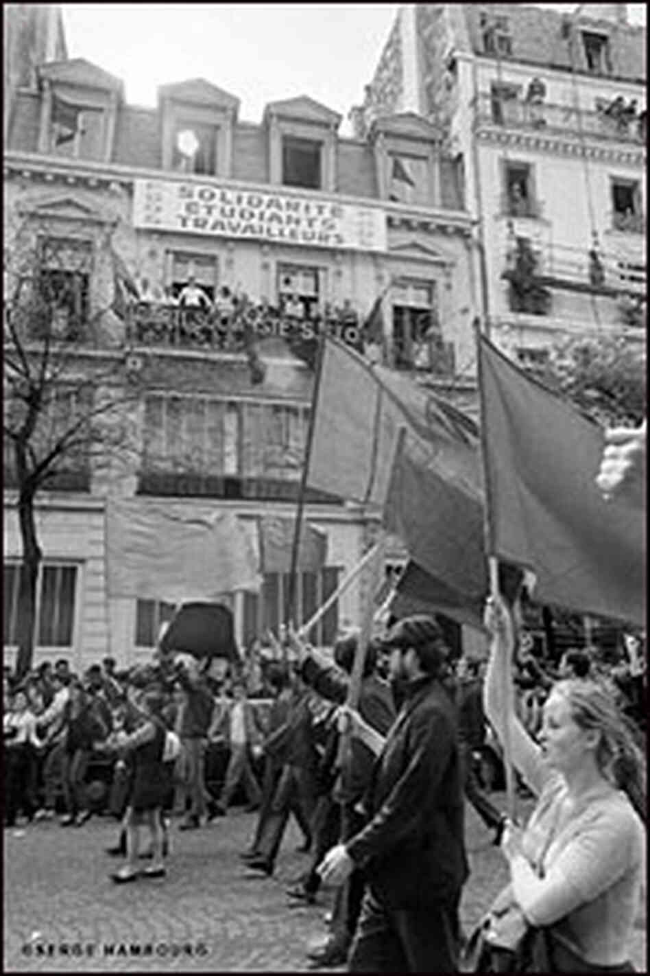 Students march in the streets of Paris in May 1968.