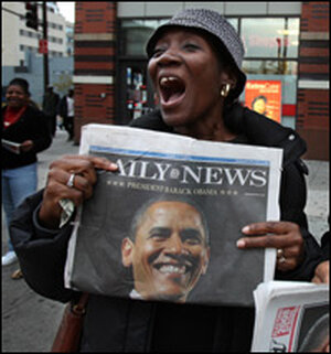 A woman in Harlem expresses her happiness Wednesday following Obama's victory.