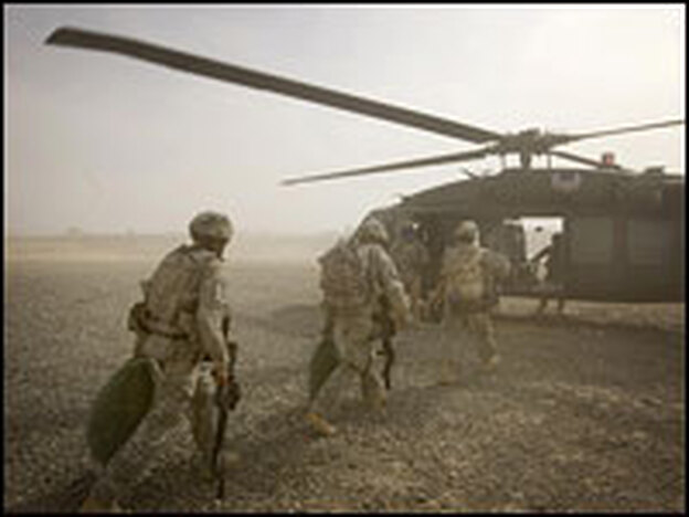 U.S. soldiers move toward a Blackhawk helicopter Friday as they are transported from their combat outpost along the Afghan-Pakistan border.