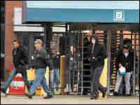 General Motors workers leave the GM Powertrain plant in Warren, Mich.