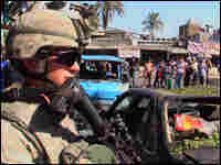 A U.S. soldier stands guard at the scene of a twin bombing in Baghdad on Nov. 10, 2008.