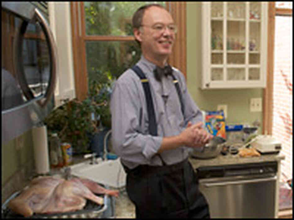 For moist, flavorful dressing, Chris Kimball recommends cooking the turkey over it in a broiling pan
