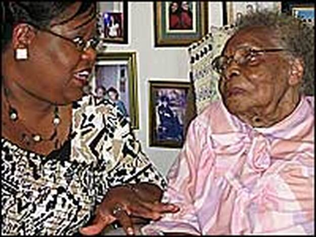 Amanda Jones, 109, visits with her granddaughter, Brenda Baker.