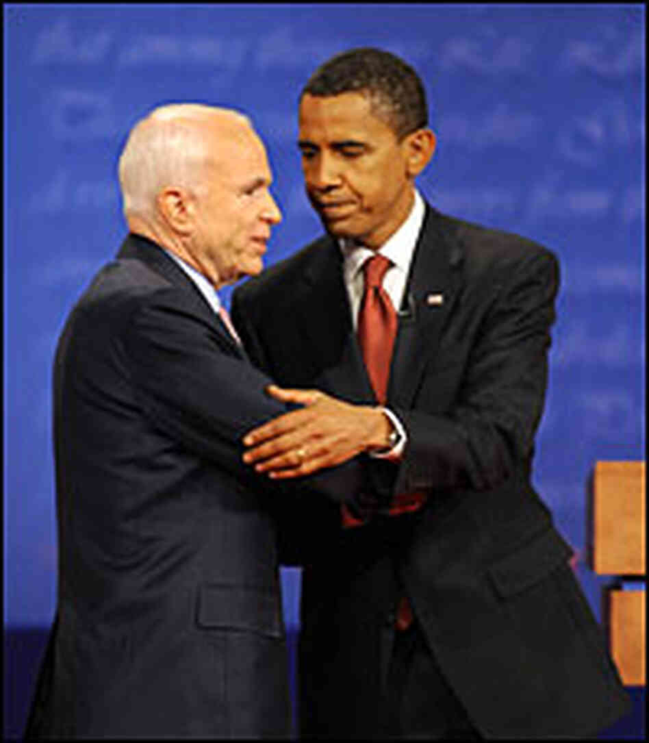 Barack Obama and John McCain shake hands after their first debate.