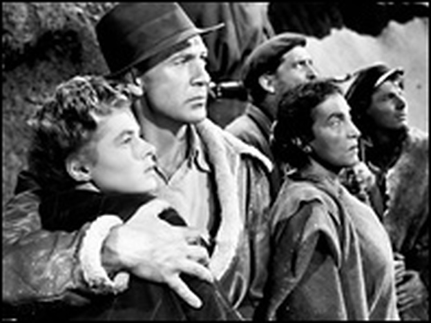 Gary Cooper (second from left, with Ingrid Bergman) played Robert Jordan in the 1943 film adaptation of Hemingway's novel, <em>For Whom The Bell Tolls</em>.