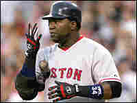 David Ortiz of the Boston Red Sox spits into his batting glove he prepares to hit in a 2006 game.