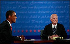 Barack Obama and John McCain both smile for the camera.