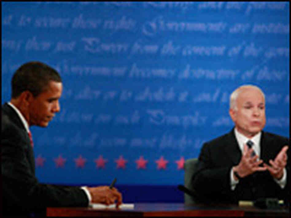Sen. John McCain speaks while Sen. Barack Obama takes notes during the final presidential debate