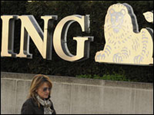 A woman walks in front of a Brussels branch of the banking giant ING.