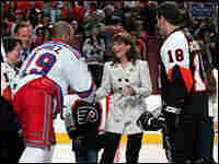 Republican vice presidential candidate Sarah Palin shakes hands with a New York Ranger.