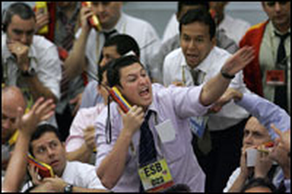 Stock traders gesture on Thursday at the Mercantile & Futures Exchange in Sao Paulo, Brazil. Fear over a global recession resulted in massive sell-offs in world markets on Friday.