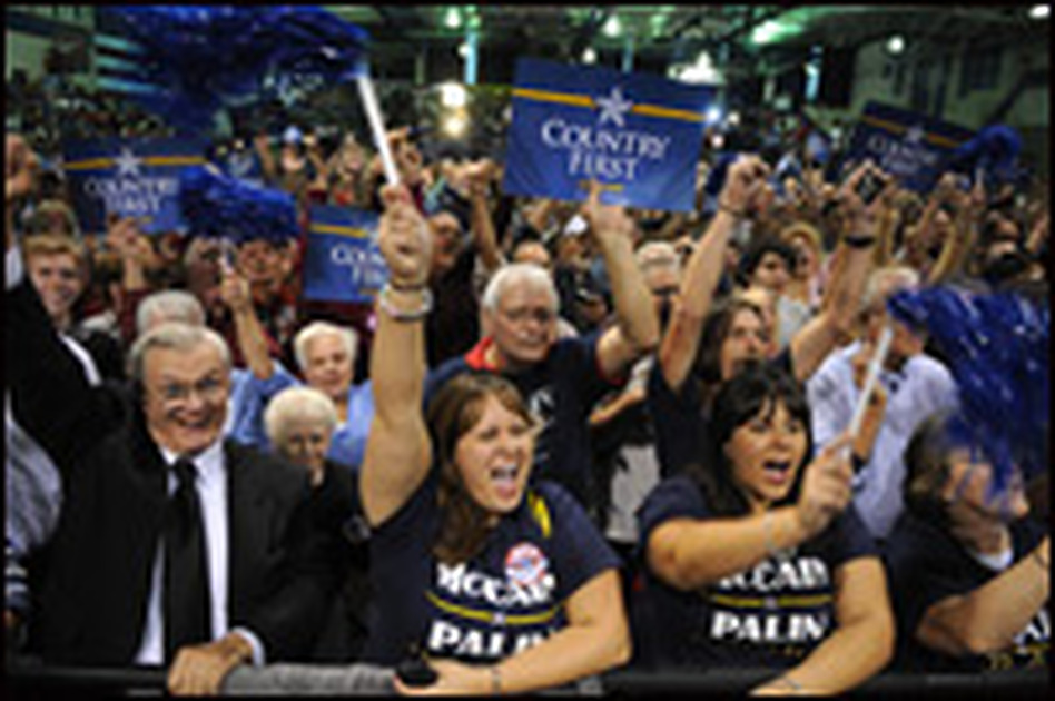 Supporters cheer for Sen. John McCain at a campaign rally at Zanesville High School in Zanesville, Ohio, on Sunday.