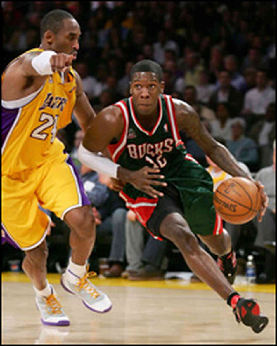 Milwaukee Bucks guard Royal Ivey attempts to drive past Kobe Bryant of the Los Angeles Lakers.