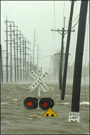 Water from the Industrial Canal in New Orleans surged over a levee and flooded a railroad crossing.