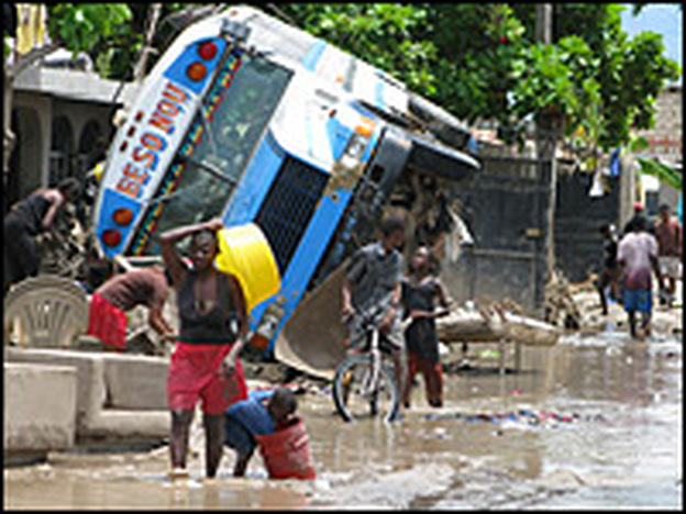 Residents of Gonaives, Haiti, attempt to clean up from Tropical Storm Hanna on Saturday. Later that night, Hurricane Ike reflooded the area.