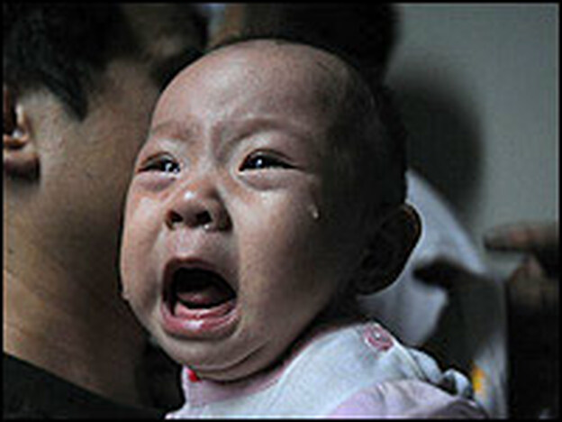 A baby who drank tainted milk powder receives an ultrasound examination Wednesday in a hospital in the city of Wuhan in China's Hubei province. (China Photos/Getty Images)