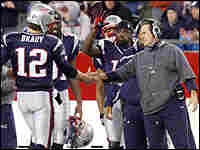 Bill Belichick (right) shakes Tom Brady's hand after a December 2007 victory.