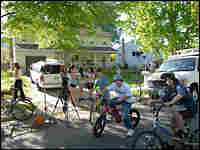 Neighborhood children gather outside the home of alleged terrorist Dritan Duka.