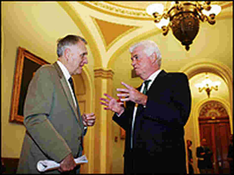 Senate Minority Whip U.S. Sen. Jon Kyl (left) talks with Chris Dodd