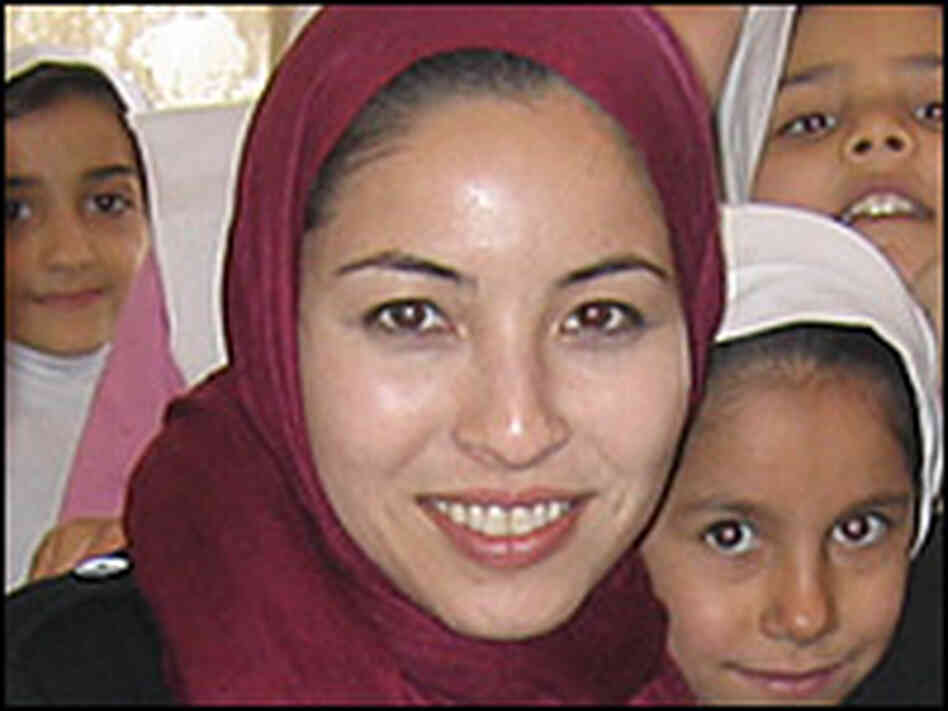 In this photo taken before her arrest, Roxana Saberi poses with schoolchildren in Iran.