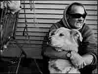 Luis Meceli, with his dog, on the streets of Skid Row