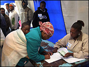A voter checks her name on a registration list Wednesday in Alexandra Township, South Africa.