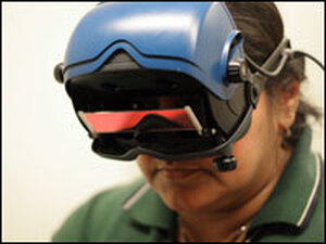 Geeta Tiwari wears infrared goggles to record eye movements that help determine the cause of her dizziness.