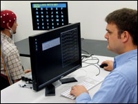 Student Adam Wilson (right) and lab member Leo Walton practice the technology.