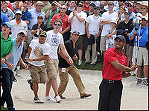 Tiger Woods hits out of a bunker during a playoff at the 2008 U.S. Open in La Jolla, Calif., captivating the gallery.
