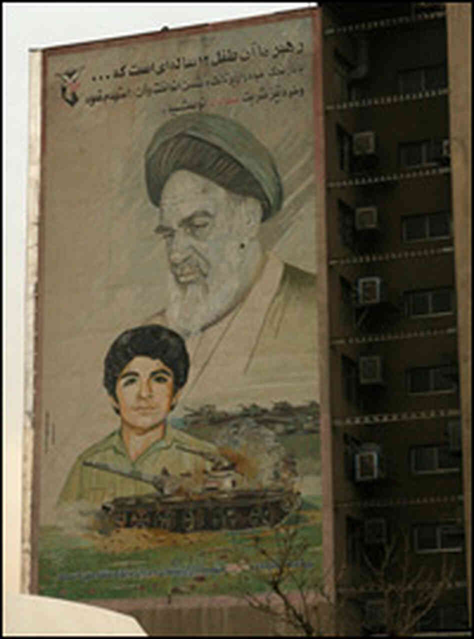 A mural shows the image of 12-year-old Hussein Fahmideh.