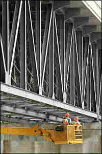 Wisconsin Department of Transportation workers inspect the Highway 51 bridge over the Rock River