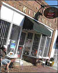 A customer sits outside Stone Soup Kitchen in Atlanta