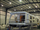 A houseboat sits in the Majestic Yachts Inc. factory in Kentucky