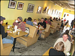 Tables are full of customers at Stone Soup Kitchen.