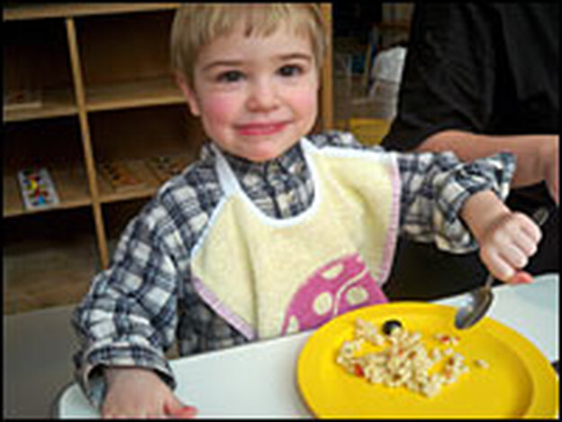 Maxime enjoys his pasta salad during lunchtime at La Margeride day care in Paris.