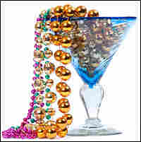 Martini glass filled with Mardi Gras beads
