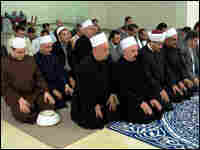 Muslim clerics pray at an interfaith service