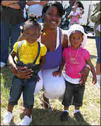 Shywona Williams, 25, stands with daughter Ciara and niece Chenel, both 2 years old, at the festival