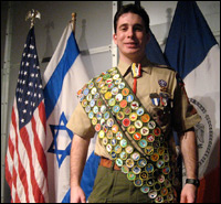 Scout Shawn Goldsmith shows off his merit badges.