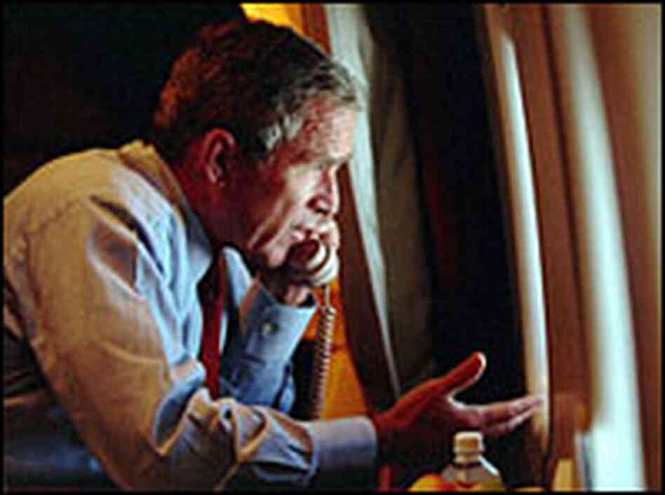 President Bush speaks to Vice President Dick Cheney by phone aboard Air Force One on Sept. 11, 2001.