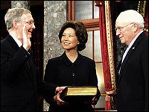 Sen. Mitch McConnell is sworn in by his wife, Labor Secretary Elaine Chao, and Vice President Cheney
