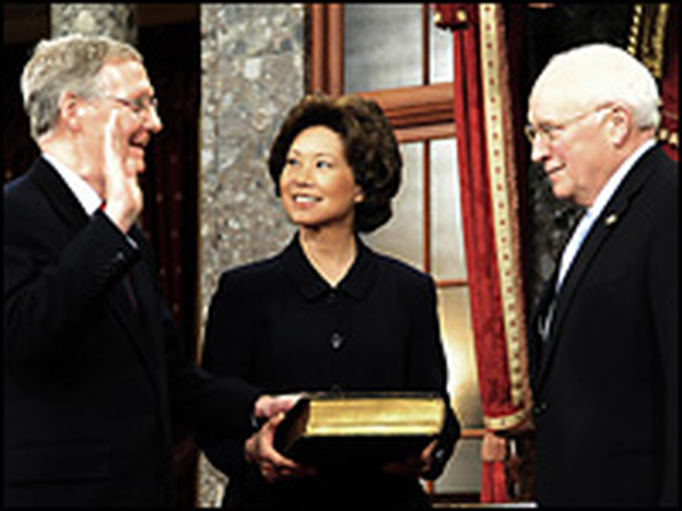 Sen. Mitch McConnell (left) is sworn in by Vice President Dick Cheney as McConnell's wife, Labor Secretary Elaine Chao, holds the Bible during a Jan. 6 re-enactment ceremony at the Capitol.