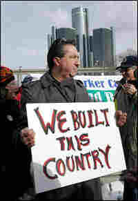 An autoworker pickets Sunday outside the auto show at Detroit's Cobo Center.