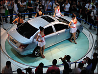 Visitors view an F3DM electric vehicle at the 2008 China High-Tech Fair on Oct. 14, 2008.